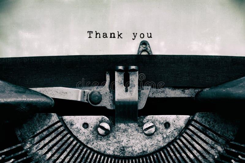 谢谢在葡萄酒打字机键入的词 库存图片