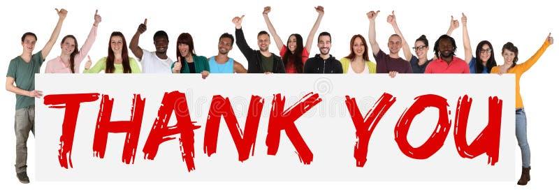谢谢签署拿着横幅的小组年轻多种族人民 库存图片