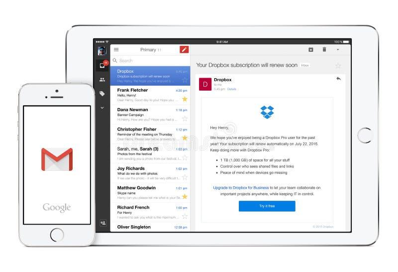 谷歌在白色苹果计算机iPad和iPhone的Gmail app 免版税库存照片