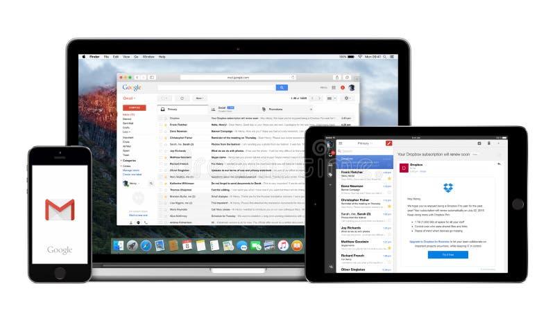 谷歌在苹果计算机iPhone iPad和Macbook赞成显示的Gmail app 库存图片