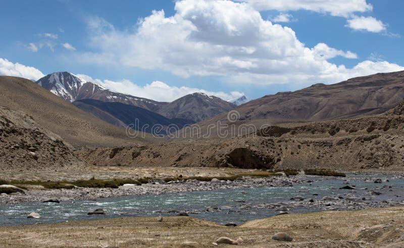 谷的风雨如磐的山河在Fann mou的山麓小丘 库存照片