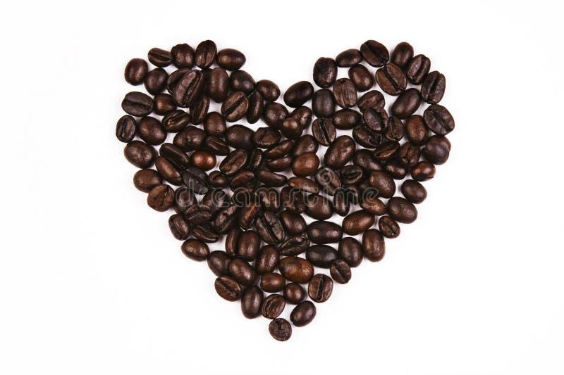 豆咖啡爱形状 免版税库存照片