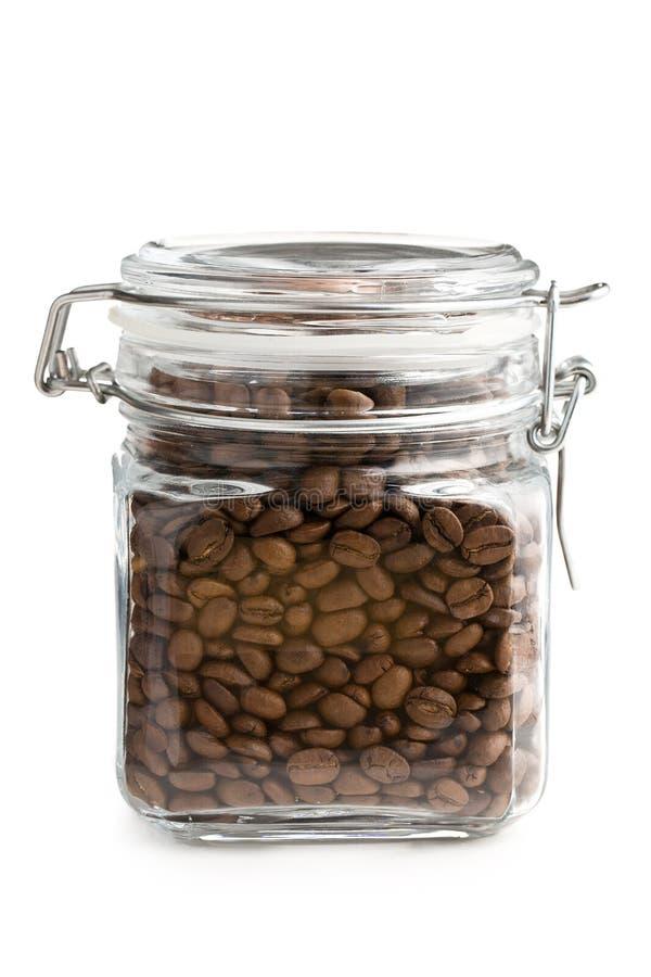 豆咖啡玻璃瓶子 免版税库存照片