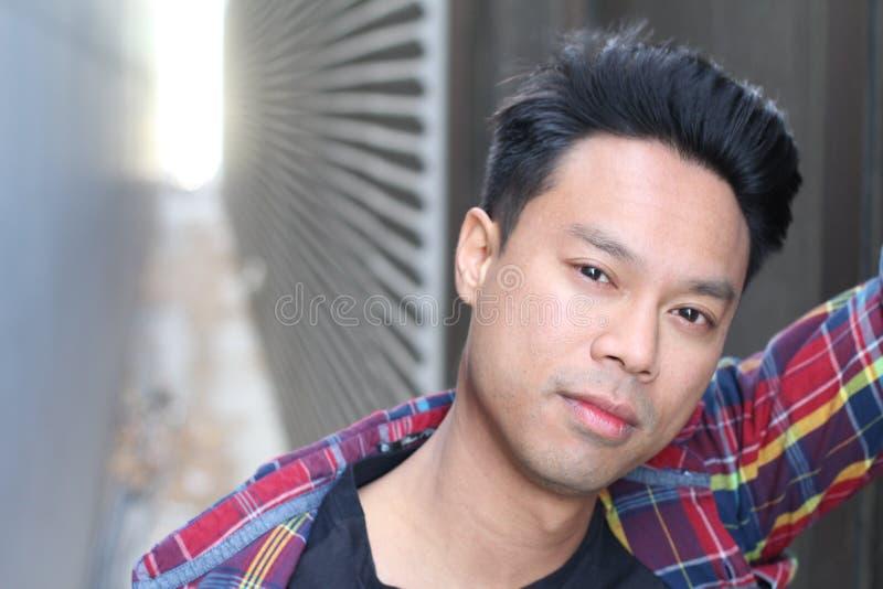 画象亚洲男性顶面式样摆在 免版税图库摄影
