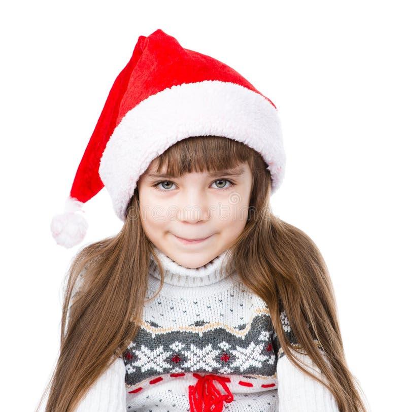 画象红色圣诞老人帽子的圣诞节女孩 查出在白色 免版税库存图片