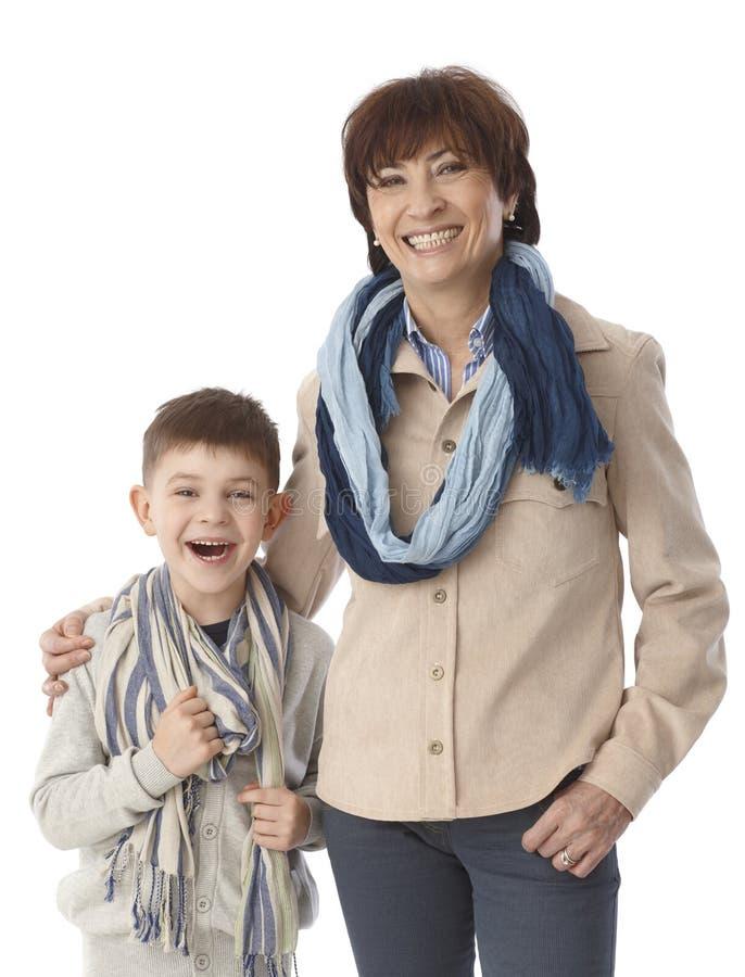 画象老婆婆和孙子微笑愉快 免版税库存图片