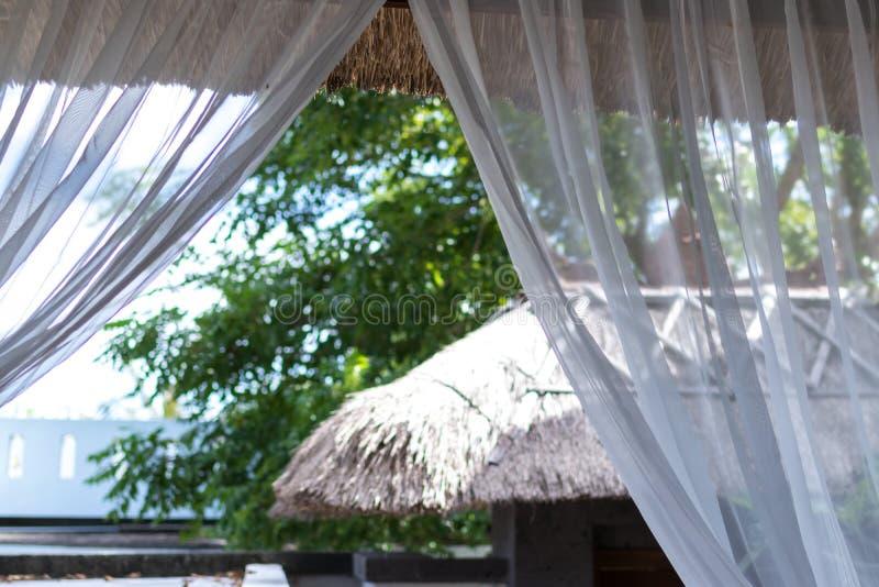 豪华家,露台,在巴厘岛,印度尼西亚的热带别墅手段 免版税库存照片