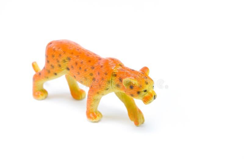 豹子在白色背景的捷豹汽车玩具 库存照片