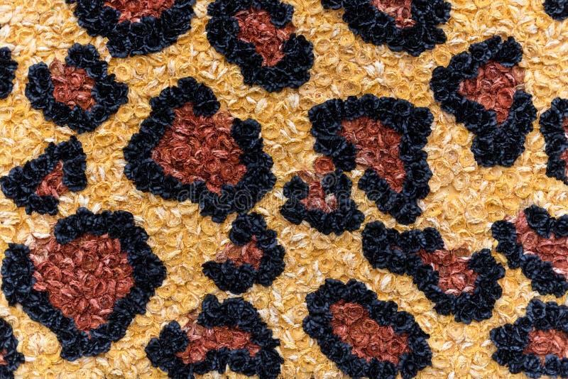 豹子纹理由纸花制成 动物印刷品背景 库存照片