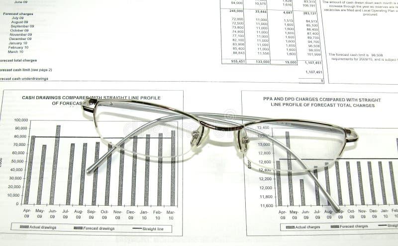 财务座标图纸眼镜 图库摄影