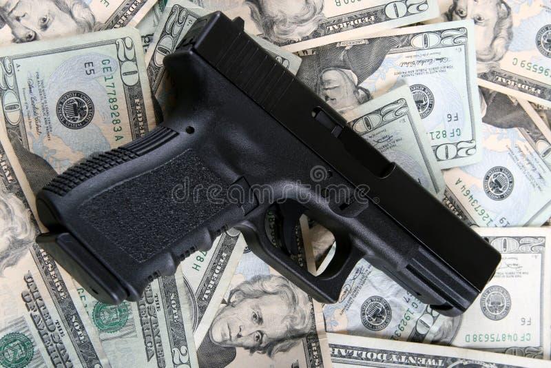 货币手枪 库存照片
