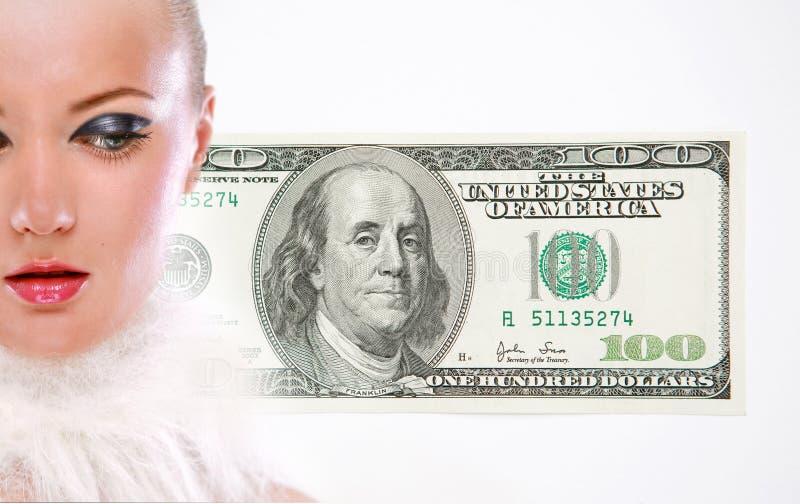货币纵向妇女年轻人 库存图片