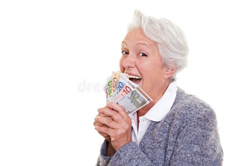 货币高级赢取的妇女 免版税库存照片