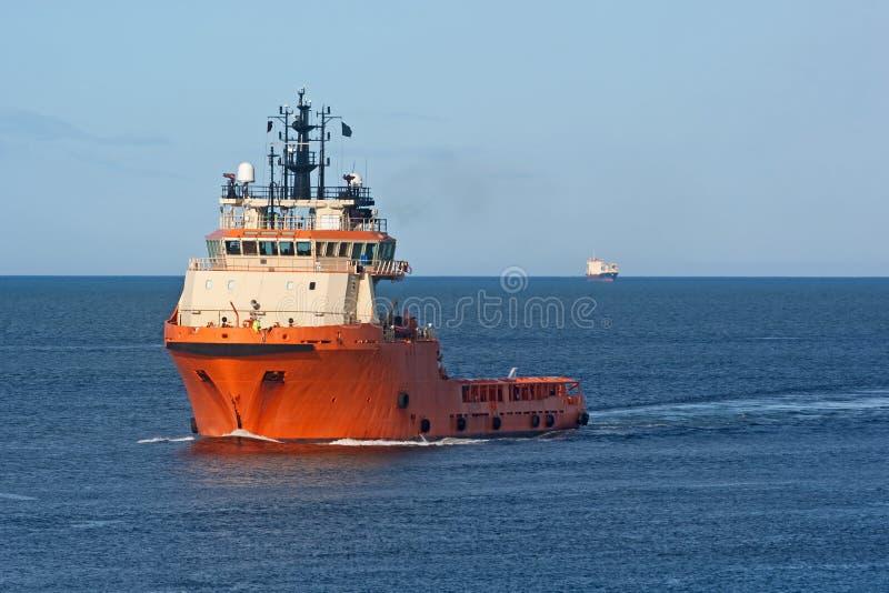 货物橙色船 免版税库存照片