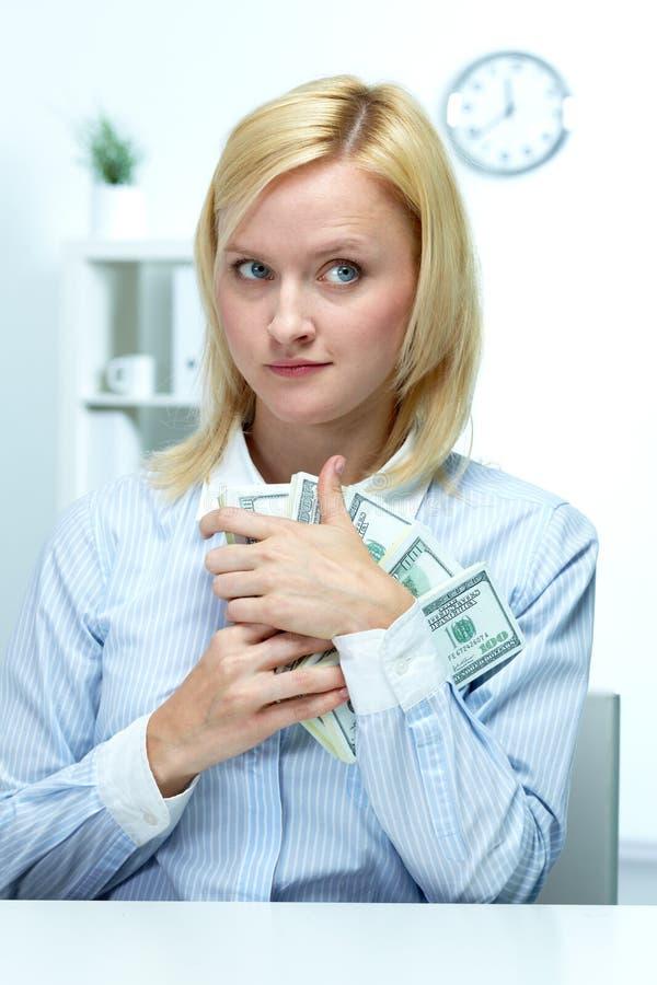 贪婪的女实业家 库存照片