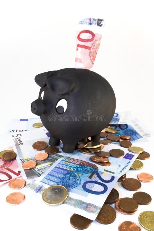 贪心银行帐单的硬币 免版税库存图片
