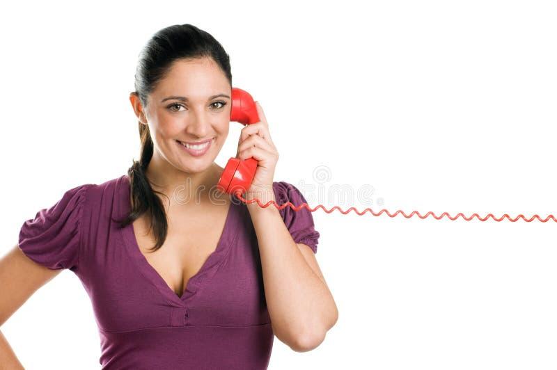 购买权运算符电话微笑的妇女年轻人 免版税图库摄影