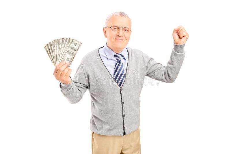 资深举行的现金和打手势幸福 免版税库存图片