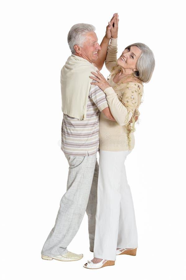 资深夫妇跳舞画象在白色背景的 免版税库存图片