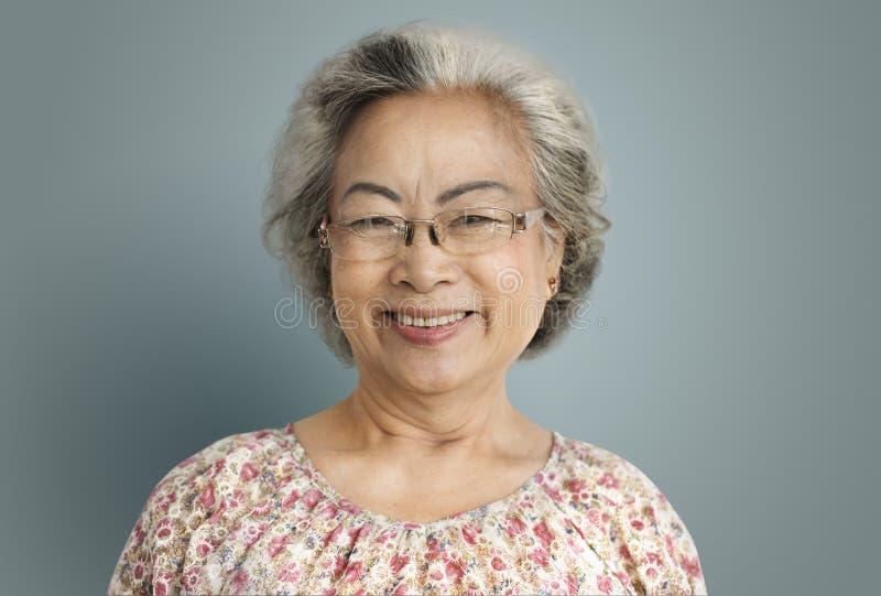 资深妇女快乐的幸福退休概念 图库摄影
