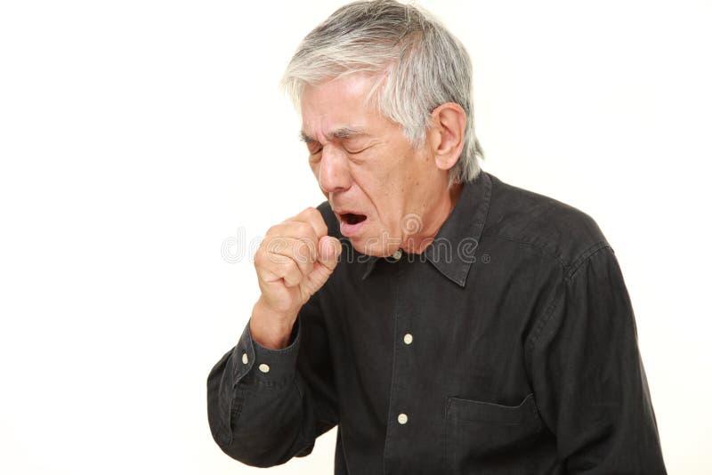 资深日本人咳嗽 图库摄影
