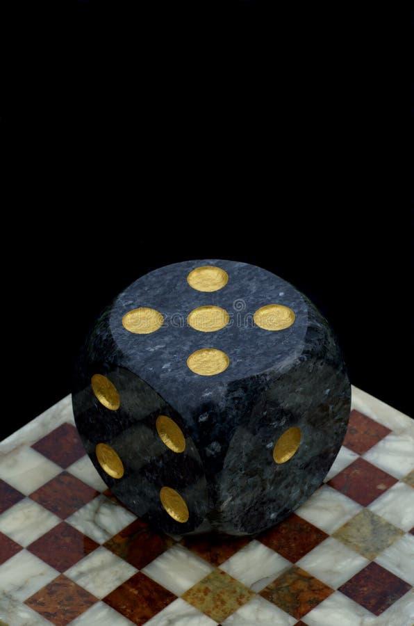 赌博反对在棋枰的顶的模子 库存图片