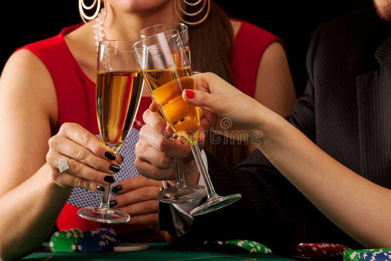 赌博的香槟欢呼 库存图片
