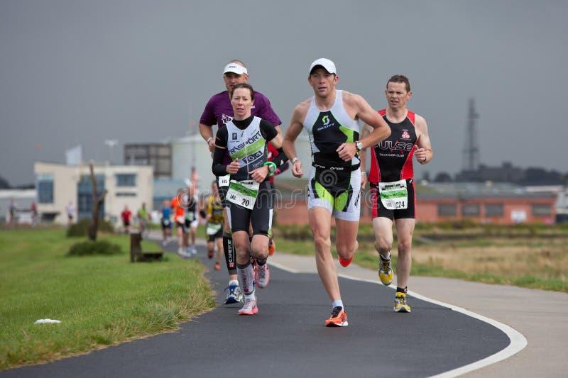 赛跑者三项全能 库存照片