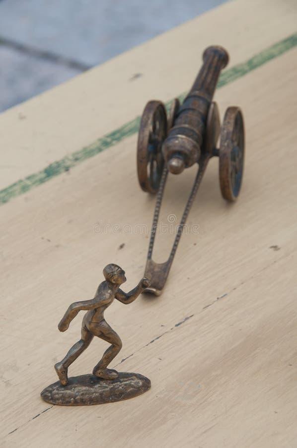 赛跑者和炮兵小雕象 免版税库存照片