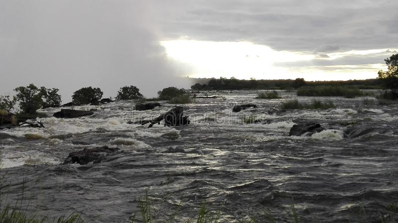 赞比西河日落赞比亚边 免版税库存图片