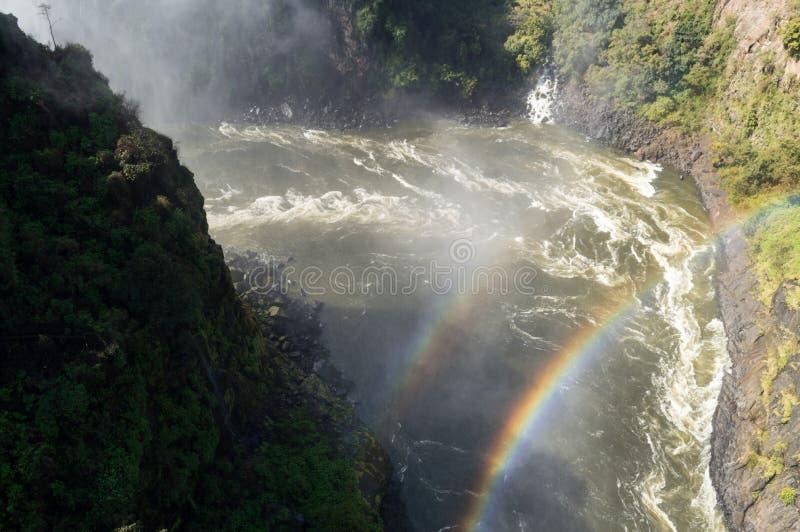 赞比西河,从维多利亚瀑布桥梁看见的双重彩虹 图库摄影
