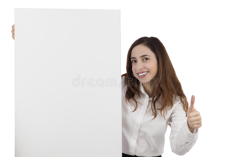 给赞许和显示一张空白的海报的女商人 免版税库存照片