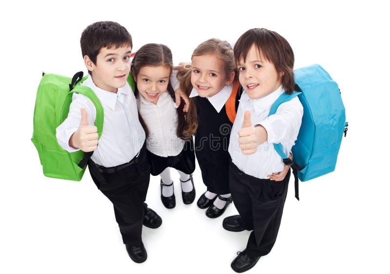 给赞许的小组孩子签字-回到学校 免版税库存图片
