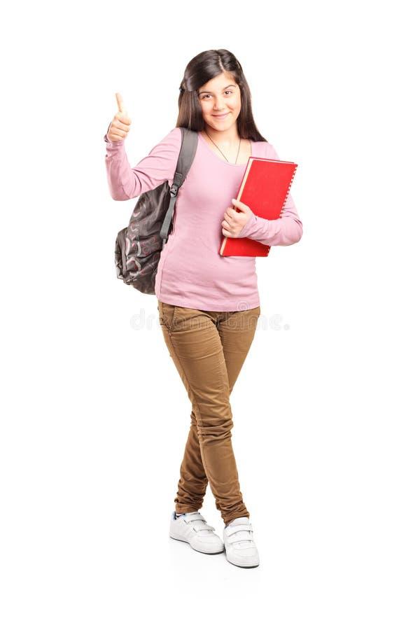 给赞许的少年女小学生 免版税库存图片