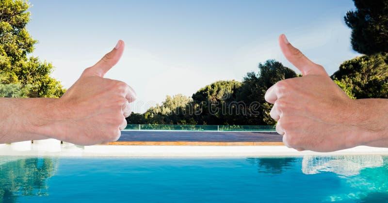 赞许的综合图象在游泳池前面的 免版税库存照片
