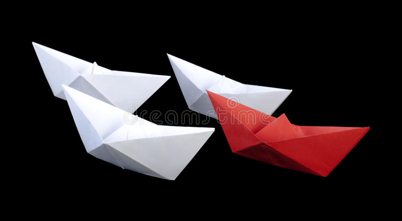 赢利地区红色纸船 库存图片