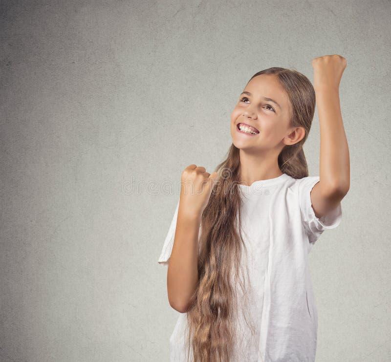 赢取成功的少年女孩的画象 免版税图库摄影