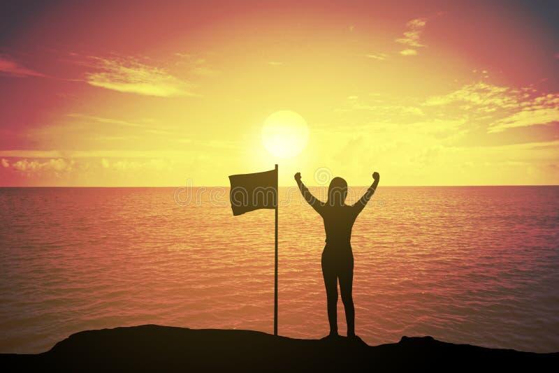 赢取的成功妇女剪影站立和举她的手的日落或日出的在庆祝的旗子附近 库存图片