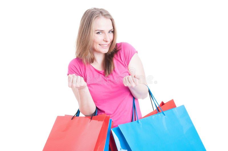 赢取购物的一个自由会议激动的少妇 免版税库存图片