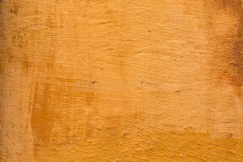 赤土陶器色的墙壁的背景纹理 免版税库存图片