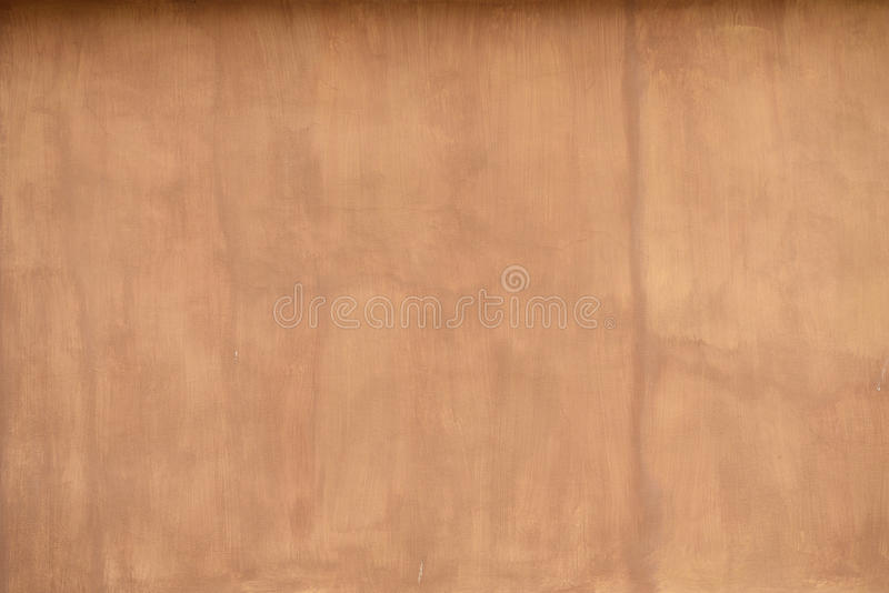 赤土陶器色的灰泥墙壁背景 免版税库存照片