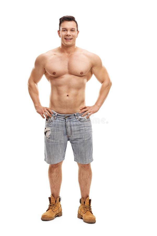 赤裸上身肌肉人摆在 免版税库存图片