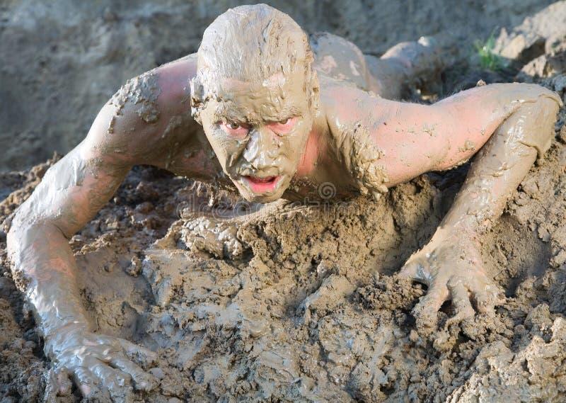赤裸人的泥 图库摄影