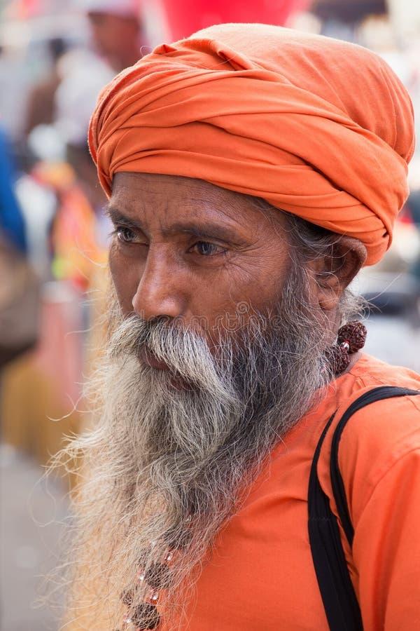 走在月光广场,德里,印度的印地安人画象 免版税库存图片