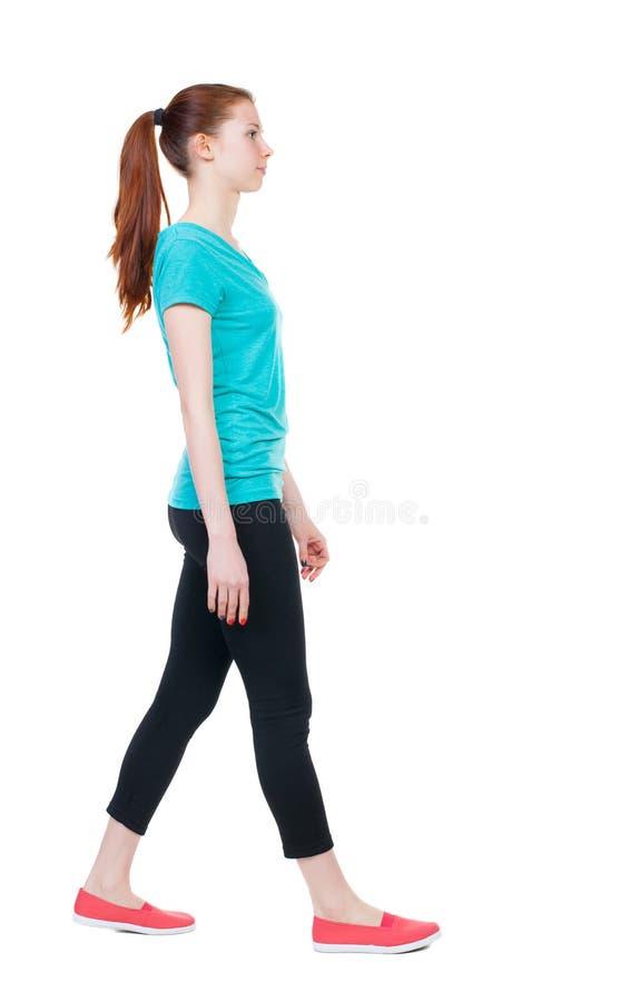 走的妇女侧视图体育贴身衬衣的 免版税库存照片
