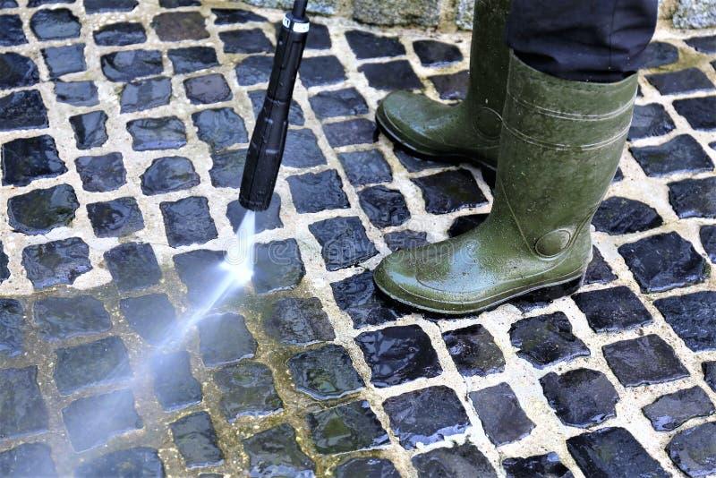 走道清洁-高压擦净剂的图象 免版税库存照片