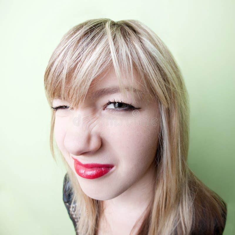 起皱纹的女孩鼻子 图库摄影
