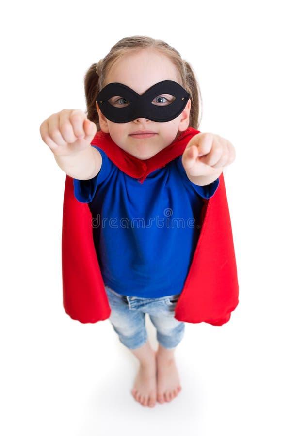 超级英雄女孩关于飞行的儿童梦想 免版税库存照片