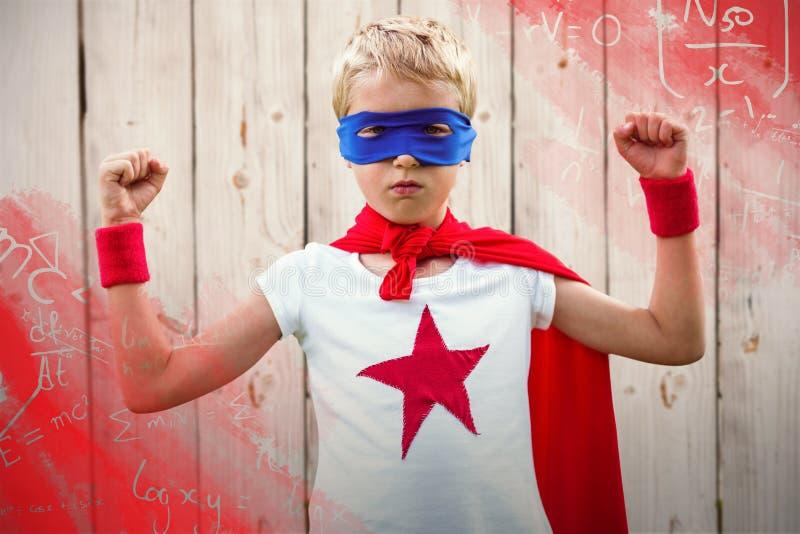 超级英雄男孩画象的综合图象有被举的胳膊的 免版税库存照片