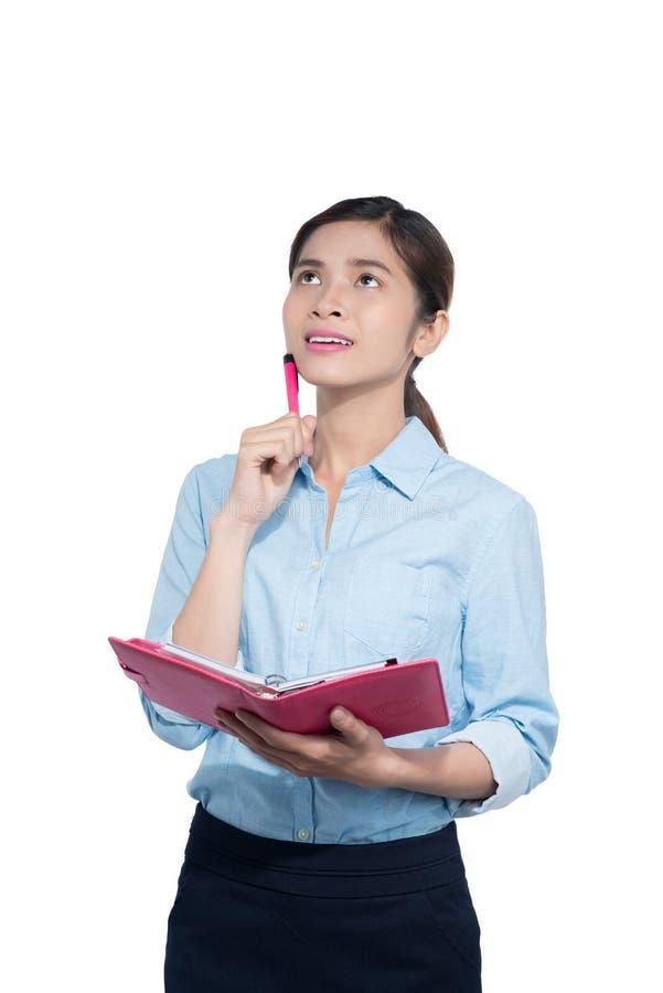 越南女实业家注意关于笔记本的 免版税图库摄影